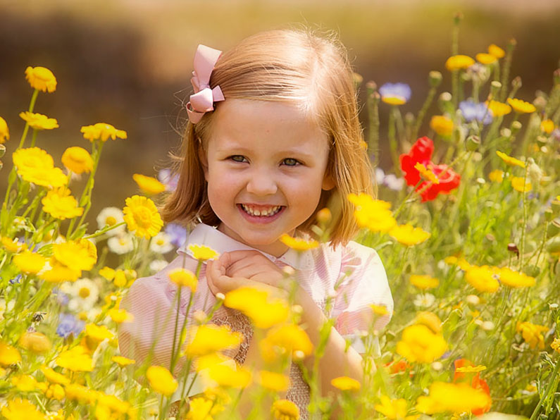 Portrait of Little Girl with Yellow Flowers